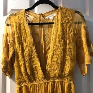 Beautiful mustard high low romper
